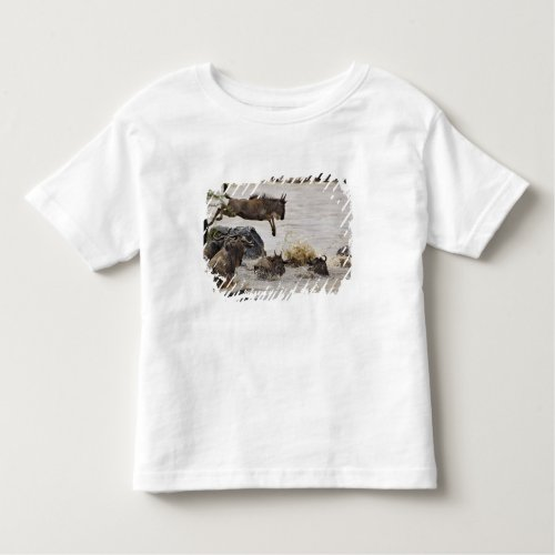 Wildebeest jumping into Mara River during Toddler T_shirt