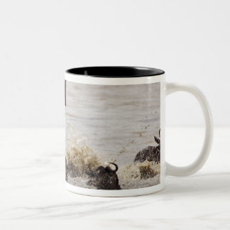 Wildebeest jumping into Mara River during Two-Tone Coffee Mug