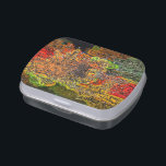 """WILDFLOWERS JELLY BELLY CANDY TIN<br><div class=""""desc"""">An abstract design of wildflowers growing in a stone wall.</div>"""