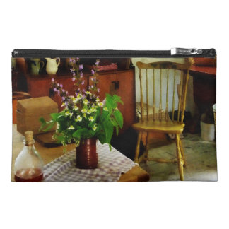 Wildflowers on Kitchen Table Travel Accessories Bags