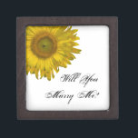 "Will You Marry Me Sunflower Engagement Ring Box<br><div class=""desc"">Ask your girlfriend to marry you  with a special marriage proposal with the pretty Will You Marry Me Sunflower Engagement Ring Box. This elegant custom floral engagement gift box features a yellow sunflower blossom with a white background.</div>"