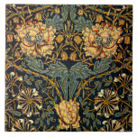 """William Morris Antique Honeysuckle Floral Pattern Ceramic Tile<br><div class=""""desc"""">This is a digitally enhanced print derived from an antique 1900 Honeysuckle floral textile pattern designed by William Morris. William Morris was a Victorian era poet, novelist, textile designer and an important figure of the British Arts and Crafts Movement. His designs had a medieval-inspired aesthetic and respect for hand-craftsmanship and...</div>"""