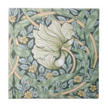 """William Morris Pimpernel Floral Design Tile<br><div class=""""desc"""">William Morris Pimpernel Floral Pattern The Pimpernel pattern by 19th Century British textile and wallpaper designer William Morris shows off a beautiful white flower, on a background of swirling green leaves, smaller blue leaves, and tiny yellow flowers. The color scheme is perfect, just a wonderful floral design with all those...</div>"""