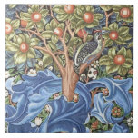 """William Morris Woodpecker Tapestry Floral Vintage Ceramic Tile<br><div class=""""desc"""">William Morris Woodpecker Tapestry Floral Vintage Art It shows a woodpecker sitting in the branch of a fruit tree and features a distinctive ornate background of blue leaves and orange fruit. Art by William Morris Movement: British Arts and Crafts / Art Nouveau Beautiful ornate artistic floral vintage fine art pattern...</div>"""