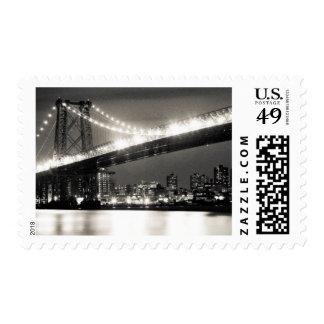 Williamsburg bridge in New York City at night Postage