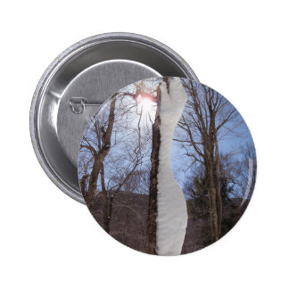Wind and snow sculpted tree button