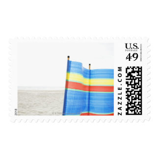 Wind Break on Beach Stamp