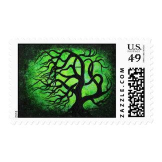 Windblown green tree -stamp