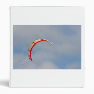 Windboard red sail against blue sky 3 ring binders