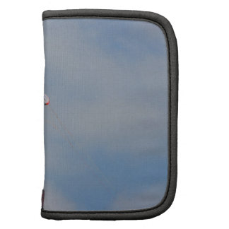 Windboard red sail against blue sky planners