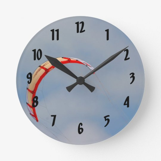 Windboard red sail against blue sky round clock