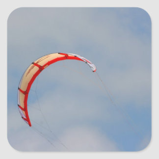 Windboard red sail against blue sky square sticker