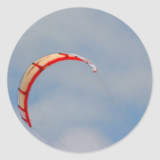Windboard red sail against blue sky classic round sticker