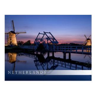 Windmills and a drawbridge at sunset bar postcard
