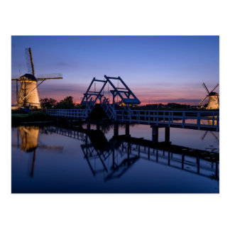Windmills and a drawbridge at sunset postcard