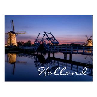 Windmills and a drawbridge at sunset text postcard