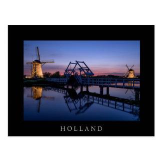 Windmills and drawbridge at sunset black postcard