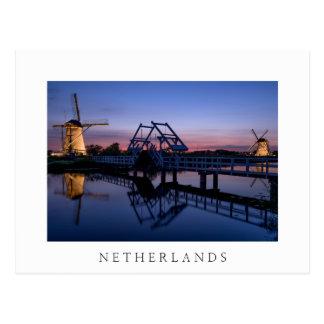 Windmills and drawbridge at sunset white postcard