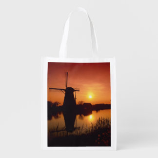 Windmills at sunset, Kinderdijk, Netherlands Grocery Bags