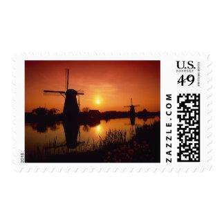 Windmills at sunset, Kinderdijk, Netherlands Stamp