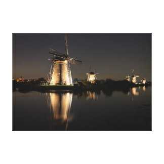 Windmills illuminated at night canvas print
