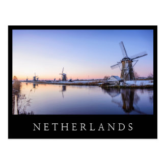 Windmills in winter black text postcard