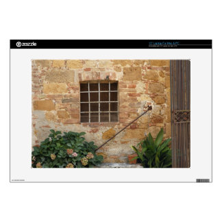 Window and ancient stone wall, Pienza, Italy Laptop Decal
