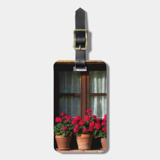Window flower pots in village bag tag