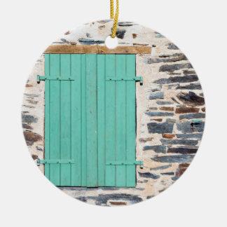 Window Shutters on a Rustic Rock Wall Ornament