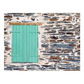 Window Shutters on a Rustic Rock Wall Postcard