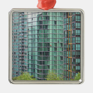Window washers on downtown high rise building metal ornament