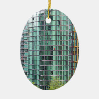 Window washers on downtown high rise building ornaments