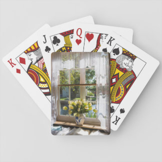 Window with lace curtain and tulips playing cards