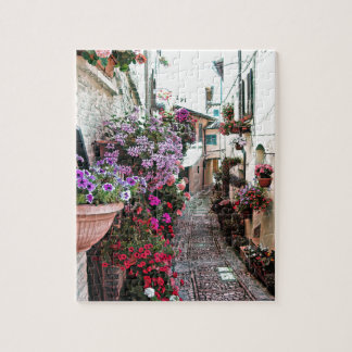 Windows, balcony and flower alleys in Spello Jigsaw Puzzle
