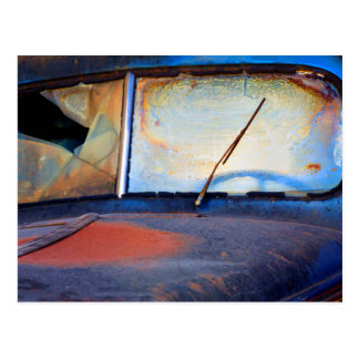 Windshield of an old rusty truck postcard
