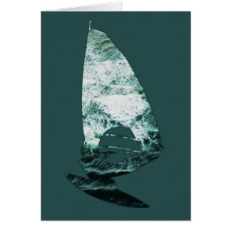 Windsurfer shoots through the waves on the beach greeting card