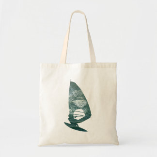 Windsurfer shoots through the waves on the beach tote bag