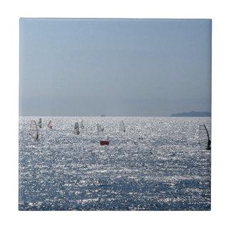 Windsurfing in the sea . Windsurfers silhouettes Ceramic Tile