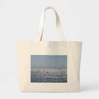 Windsurfing in the sea . Windsurfers silhouettes Large Tote Bag