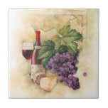 "Wine and Cheese Tile<br><div class=""desc"">Enter your initial. Blue. Still life with wine and cheese on textured background.  Not bad for your foodie. Good visual for any culinary theme.</div>"