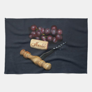 Wine bottle corks, corkscrew and grapes kitchen towel