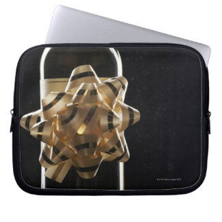 Wine bottle with bow computer sleeves