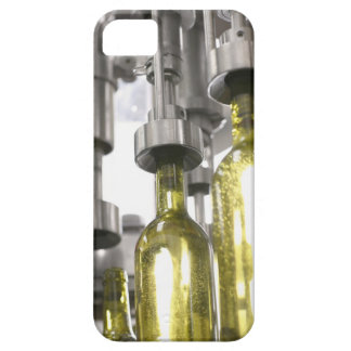 wine bottles being filled with wine at factory iPhone 5 case