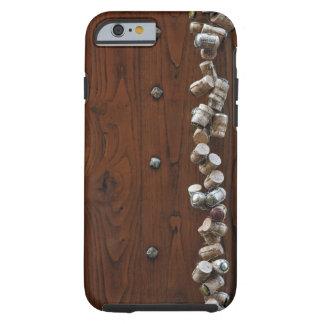 Wine corks hanging on wooden door tough iPhone 6 case
