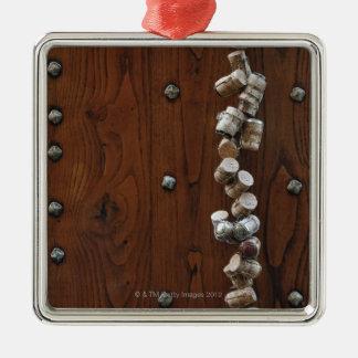 Wine corks hanging on wooden door metal ornament