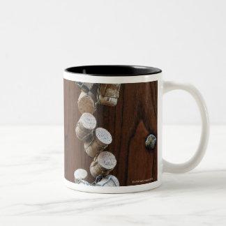Wine corks hanging on wooden door Two-Tone coffee mug