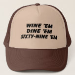 "Wine &#39;em Dine &#39;em 69 &#39;em Trucker Hat<br><div class=""desc"">This trucker hat was worn by SeaBass in the 90&#39;s cult classic movie Dumb &amp; Dumber. Get your wine em dine em sixty nine em hat today!</div>"