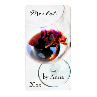Wine glass with grape tendril label