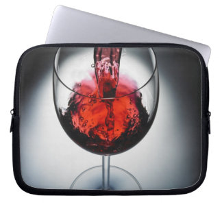 Wine poured in glass computer sleeve