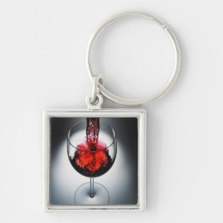 Wine poured in glass key chains